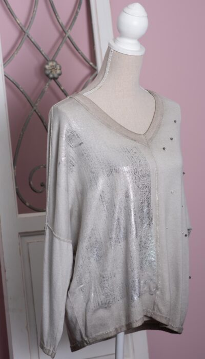 a soft warm long sleeve jumper with a v-neck. Designer details such as shimmer paint and pearls
